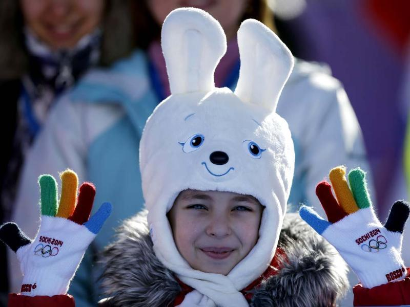 A girl wears a hat in the shape of the Sochi Winter Olympics mascot while watching the men's snowboard slopestyle qualifying at the Rosa Khutor Extreme Park ahead of the 2014 Winter Olympics in Krasnaya Polyana, Russia. (AP photo)