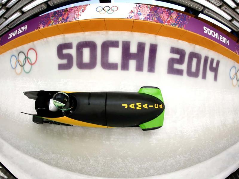 Jamaica's two-man bobsleigh pilot Winston Watts speeds down the track during an unofficial progressive training at the Sanki sliding center in Rosa Khutor, a venue for the Sochi 2014 Winter Olympics near Sochi.(Reuters photo)