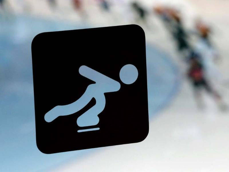 A speedskating logo stands printed on a window as athletes train at the Adler Arena Skating Center during the 2014 Winter Olympics in Sochi, Russia. (AP photo)