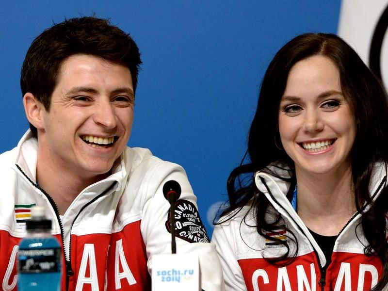 Canadian figure skating dance pair Tessa Virtue and Scott Moir speak at a press conference by Canada's figure skating team in Sochi. (AFP photo)