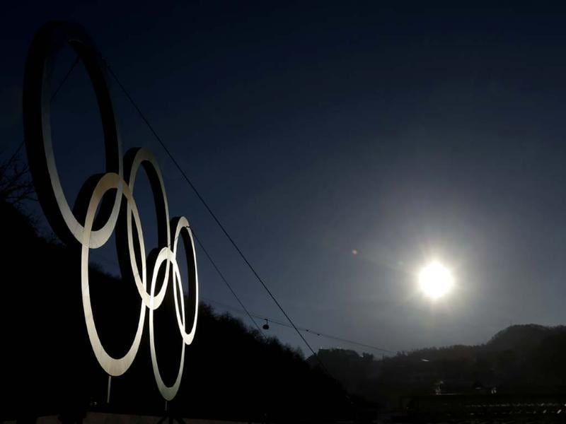 The sun rises above the Caucasus Mountains beyond a set of Olympic Rings in Rosa Khutor, Russia. The area will host the alpine events at the 2014 Winter Olympics. (AP photo)