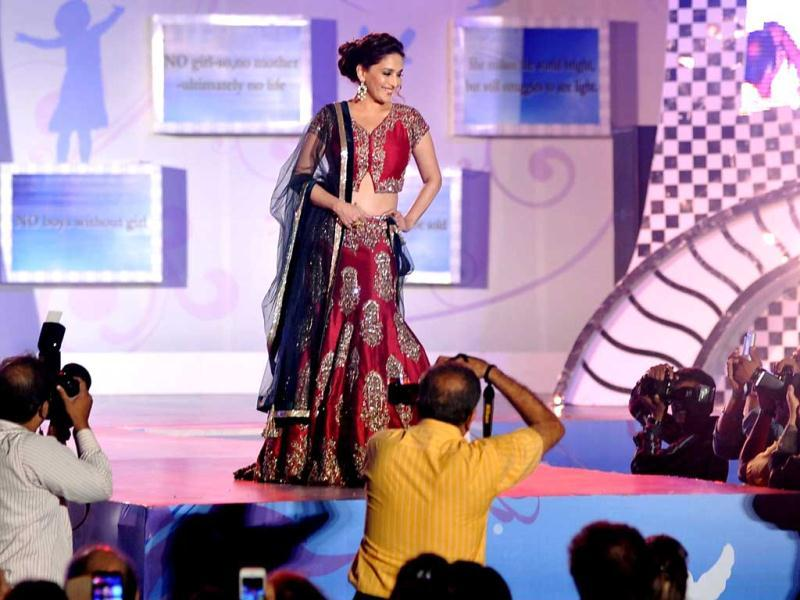 Madhuri Dixit Nene displays a creation by designer Manish Malhotra during a fashion show for 'Save & Empower The Girl Child' in Mumbai. (AFP)