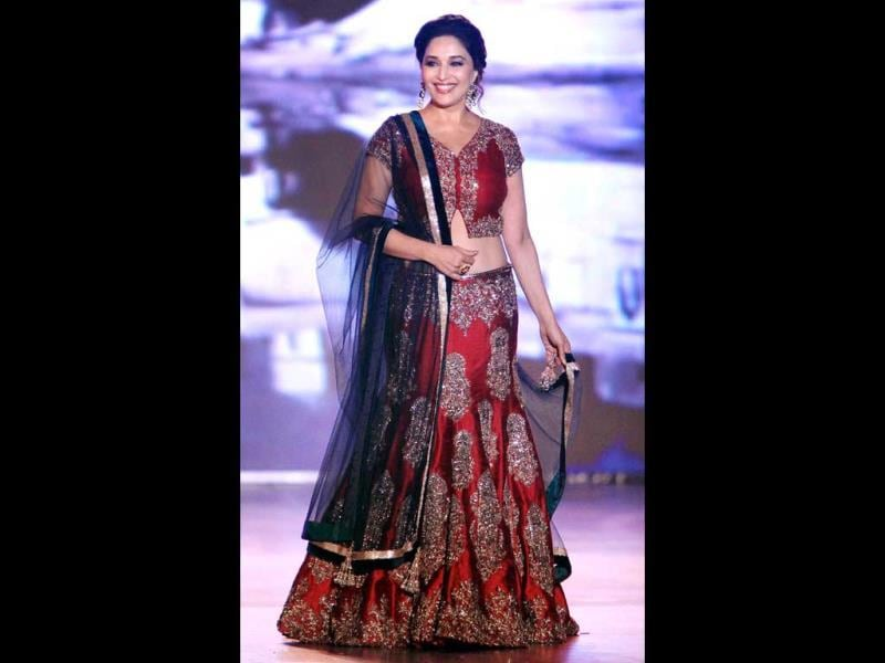 Bollywood actress Madhuri Dixit Nene walks the ramp for 'Save & Empower the Girl Child' initiative by Lilavati hospital in Mumbai. (PTI)