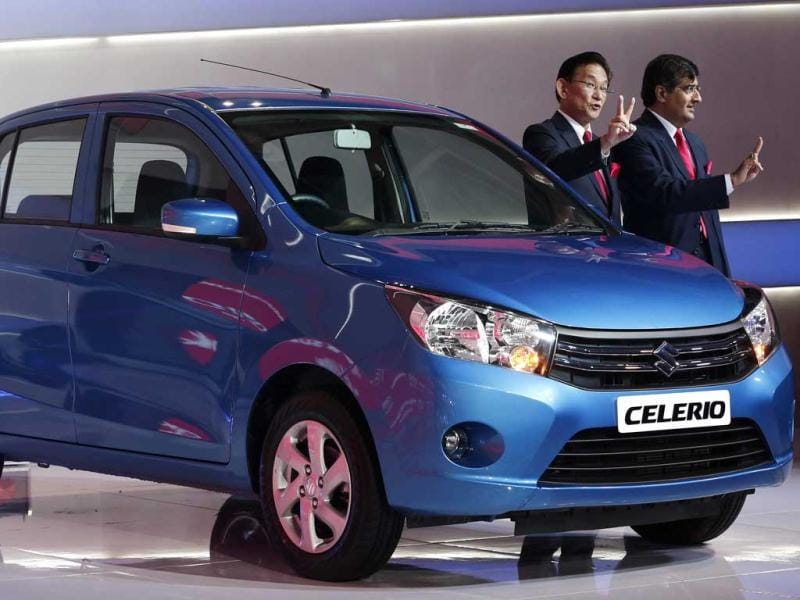 Kenichi Ayukawa (L), managing director and CEO of Maruti Suzuki India Ltd, and Mayank Pareek, Maruti's chief operating officer for marketing and sales, pose with the company's Celerio during its launch at the Indian Auto Expo in Greater Noida, on the outskirts of New Delhi. REUTERS