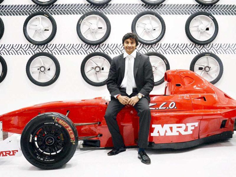 Greater Noida: Formula One racing driver Narain Karthikeyan visits the MRF stall at the Auto Expo 2014 at Greater Noida on Thursday. PTI