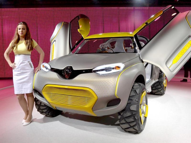 While the money is good, car and bike girls at Auto Expo fear 'harrowing crowds' and misbehaviour. A model stands alongside the Renault concept KWLD motor-car at the 12th Indian Auto Expo 2014 in Greater Noida, on the outskirts of New Delhi. (AFP Photo)