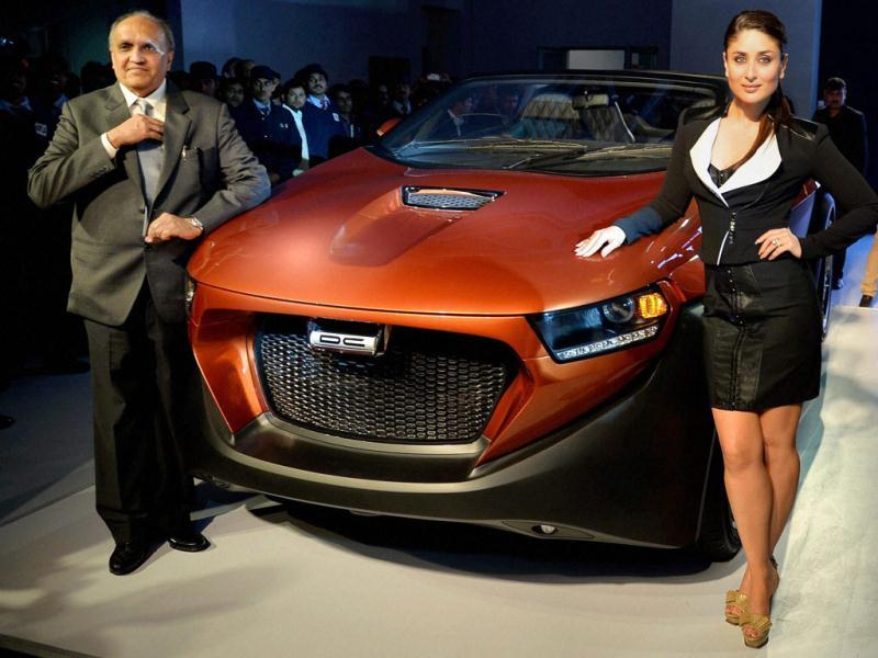 Actress Kareena Kapoor and designer Dilip Chhabria pose next to designer car Eleron at the Auto Expo 2014 in Greater Noida. (PTI)