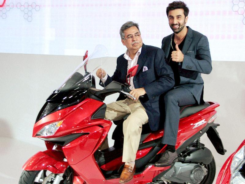 Bollywood actor Ranbir Kapoor with Pawan Munjal MD and CEO, Hero MotoCorp at the unveiling of the new range of bikes during the 12th Auto Expo 2014 in Greater Noida. (PTI)