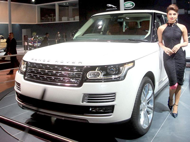 Actress Priyanka Chopra poses with Jaguar Land Rover's Range Rover LWB during its unveiling at the 12th Auto Expo 2014. (PTI)