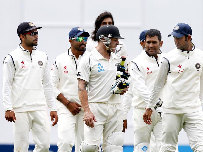 New Zealand's Brendon McCullum (C) is congratulated by some players of the Indian team after scoring 224 runs on day two of the first Test against India at Eden Park in Auckland. (Reuters Photo)