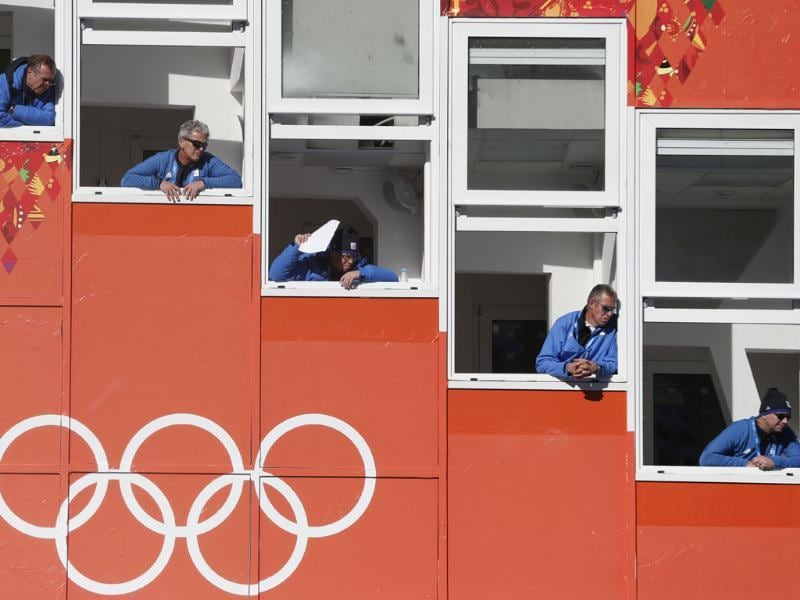 Judges watch an attempt during the men's normal hill ski jumping training at the 2014 Winter Olympics in Krasnaya Polyana, Russia. (AP photo)