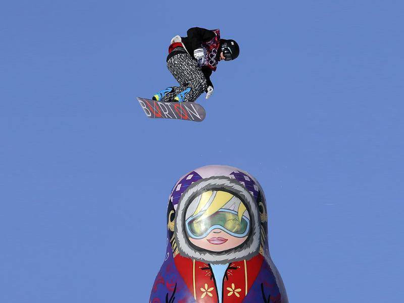 Finland's Peetu Piiroinen takes a jump near a giant matryoshka doll during snowboard slope style training at the Rosa Khutor Extreme Park ahead of the 2014 Winter Olympics in Krasnaya Polyana, Russia. (AP photo)