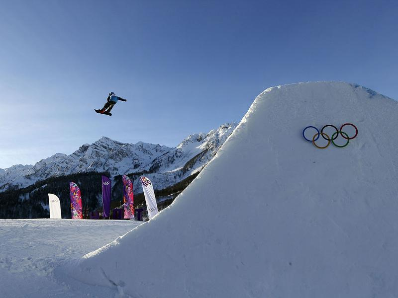 A competitor takes a jump during snowboard slope style training at the Rosa Khutor Extreme Park ahead of the 2014 Winter Olympics in Krasnaya Polyana, Russia. (AP photo)