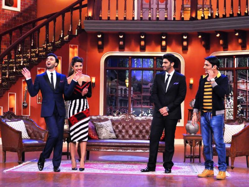 Priyanka Chopra, Arjun Kapoor and Kapil Sharma look on as Ranvir Singh poses during Comedy Night with Kapil.
