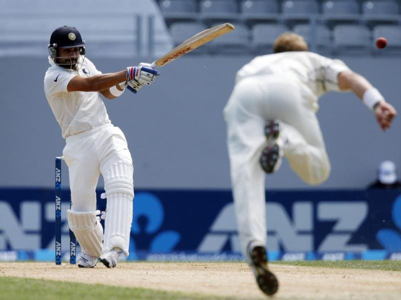 Virat Kohli (L) hits a four off New Zealand's Neil Wagner (R) during the second innings on day four of the first Test at Eden Park in Auckland. (Reuters Photo)