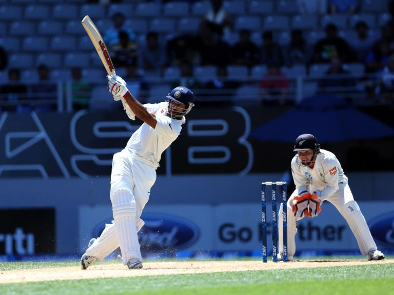Shikhar Dhawan bats as New Zealand's BJ Watling looks on during day four of the first Test match at Eden Park in Auckland. (AFP Photo)