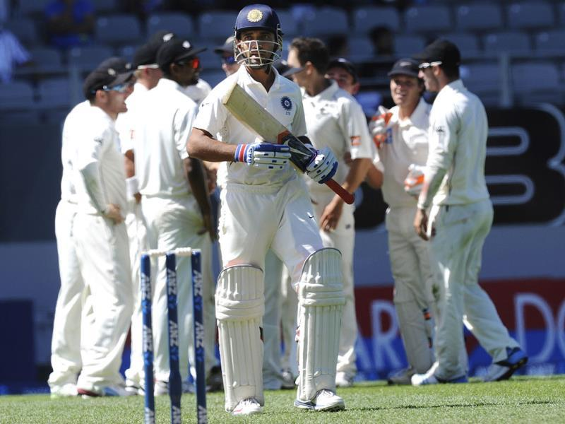 Ajinkya Rahane walks back after being dismissed by New Zealand's Trent Boult on the fourth day of the first Test at Eden Park in Auckland. (AP Photo)