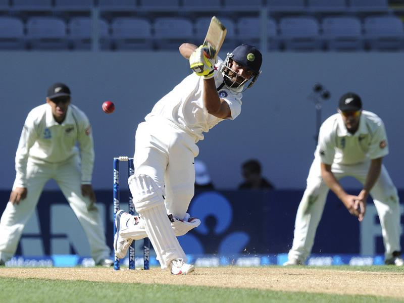 Ravindra Jadeja hits out to be caught by New Zealand's Ish Sodhi for 26 on the fourth day of the first Test at Eden Park in Auckland. (AP Photo)