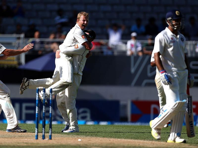 New Zealand's Neil Wagner (2nd-L) with Brendon McCullum celebrates the wicket of MS Dhoni during day four of the first Test against India at Eden Park in Auckland. (AFP Photo)