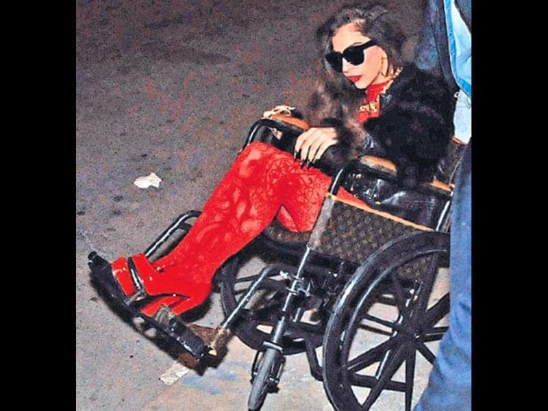 In 2013, Lady Gaga didn't let a hip injury gnaw at her spirits. The American pop star took a stylish ride in a swanky Louis Vuitton wheel chair, for a night out with boyfriend Taylor Kinney. (HT Photo)