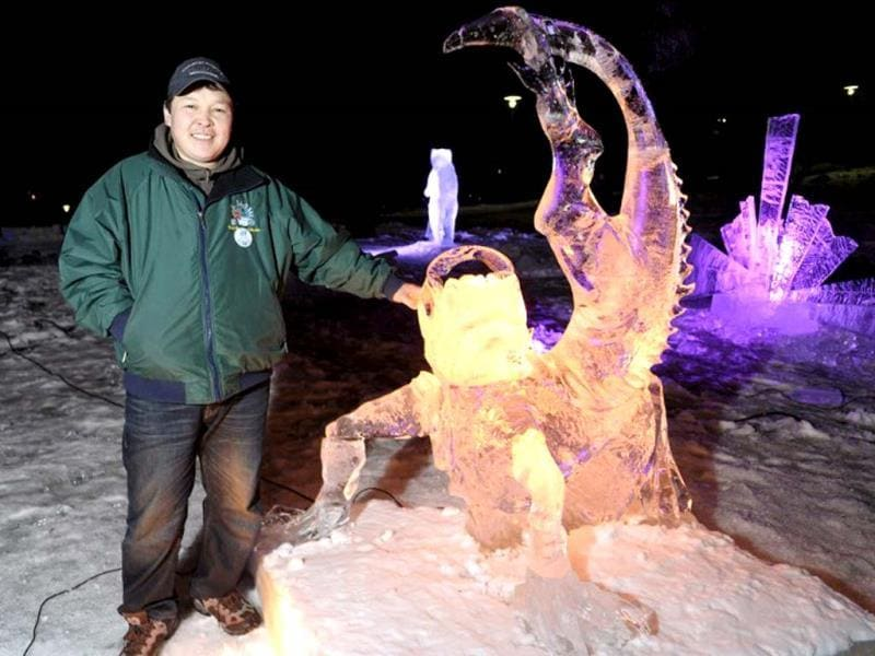 Mongolian artist Lkhagvadorj Dorjsuren pictured during the international ice sculpting festival Art Meets Ice in Korkeasaari Zoo in Helsinki. (AFP Photo)