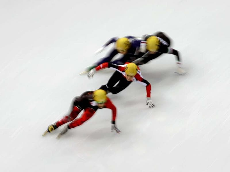 Skaters compete in a men's 1,500m short track speedskating heat at the 2014 Winter Olympics. (AP Photo)