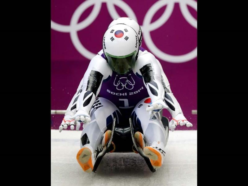 The doubles team of Park Jinyong and Cho Jung Myung from South Korea start their run during the men's doubles luge training session at the 2014 Winter Olympics. (AP Photo)