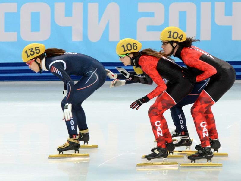 (L-R) South Korea's Cho Ha-Ri, Canada's Jessica Hewitt and Canada's Marie-Eve Drolet compete in the women's short track 3000 m relay semifinals at the Sochi Winter Olympics. (AFP Photo)