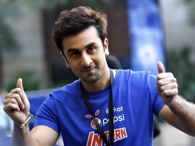 Ranbir Kapoor displays thumbs-up sign during a promotional event of soft drink in Bangalore on Wednesday. (AP Photo)