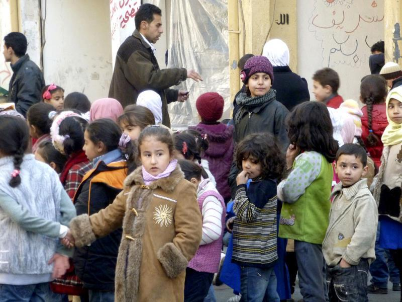 Children stand in line during a day of recreational activities organised by Jenin Sports Club at the besieged Palestinian refugee camp of Yarmouk, south of Damascus. (Reuters)