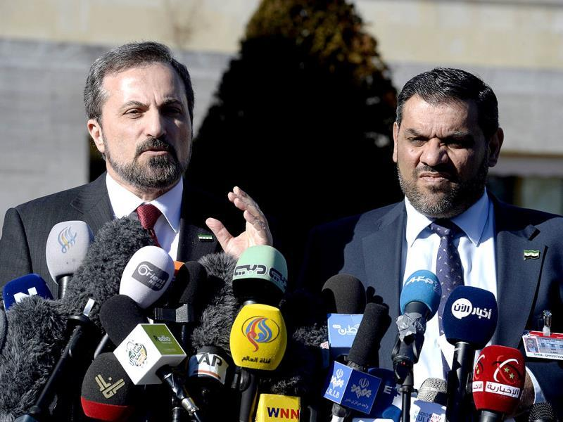 Louay Safi (L), spokesperson for the Syrian National Coalition, talks next to opposition delegation member Anas al-Abda during a press conference on the sideline of the Syrian peace talks at the United Nations in Geneva. (AFP photo)