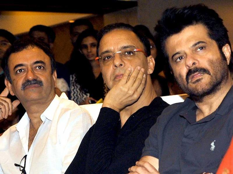 Director Rajkumar Hirani, producer and director Vidhu Vinod Chopra and actor Anil Kapoor are engrossed in the discourse at the launch of the book 'Sagar Movietone', written & compiled by Biren Kothari. (AFP Photo)