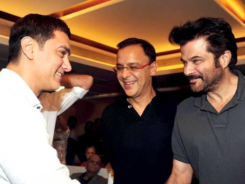 Aamir Khan with producer-director Vidhu Vinod Chopra and Anil Kapoor. (AFP Photo)
