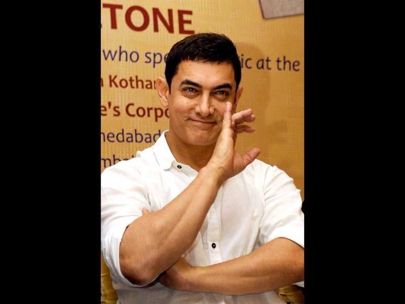 Aamir Khan poses for a photograph during the launch of Sagar Movietone, written & compiled by Biren Kothari in Mumbai on late February 11, 2014. (AFP Photo)