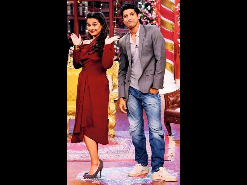 Vidya Balan, looking radiant in a red dress, and Farhan Akhtar on the sets of a TV show.