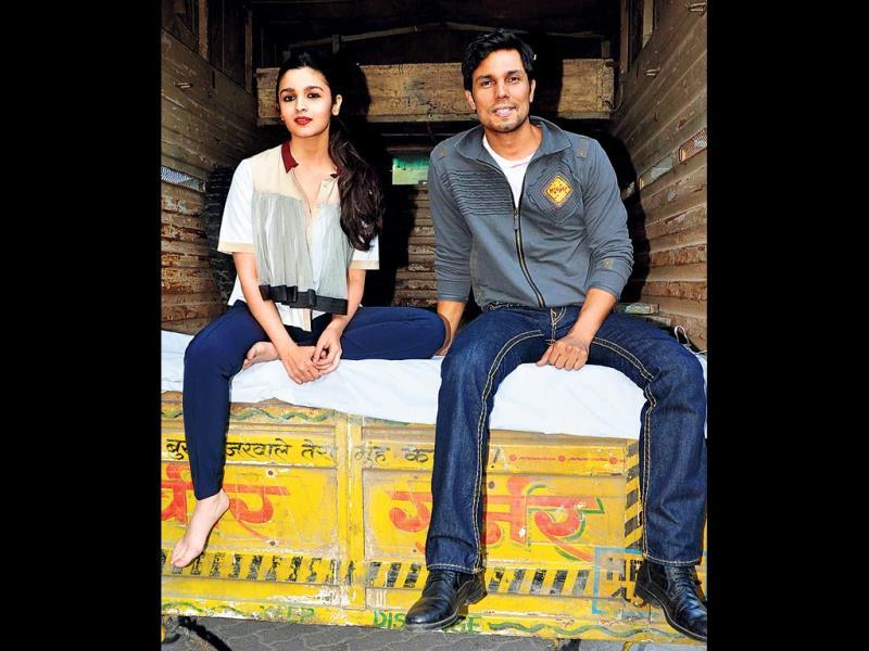 Alia Bhatt and Randeep Hooda take a ride in the back of a truck, at an event in Mumbai.