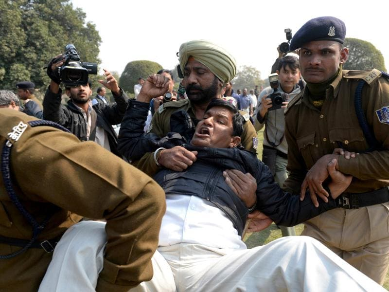 A demonstrator demanding a separate state of Telangana is detained by policemen outside Parliament. (AFP Photo)