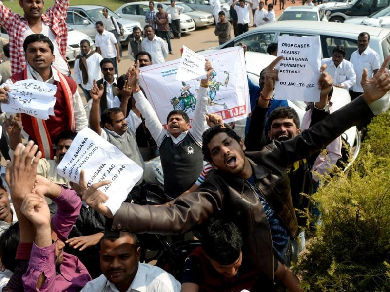 Demonstrators demanding a separate state of Telangana shout slogans outside Parliament in New Delhi. (AFP Photo)