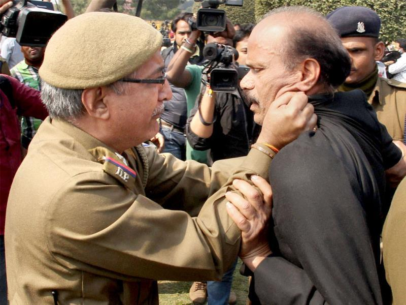 Police detain one of the Telangana supporters during a protest at Vijay Chowk in New Delhi. (PTI Photo)