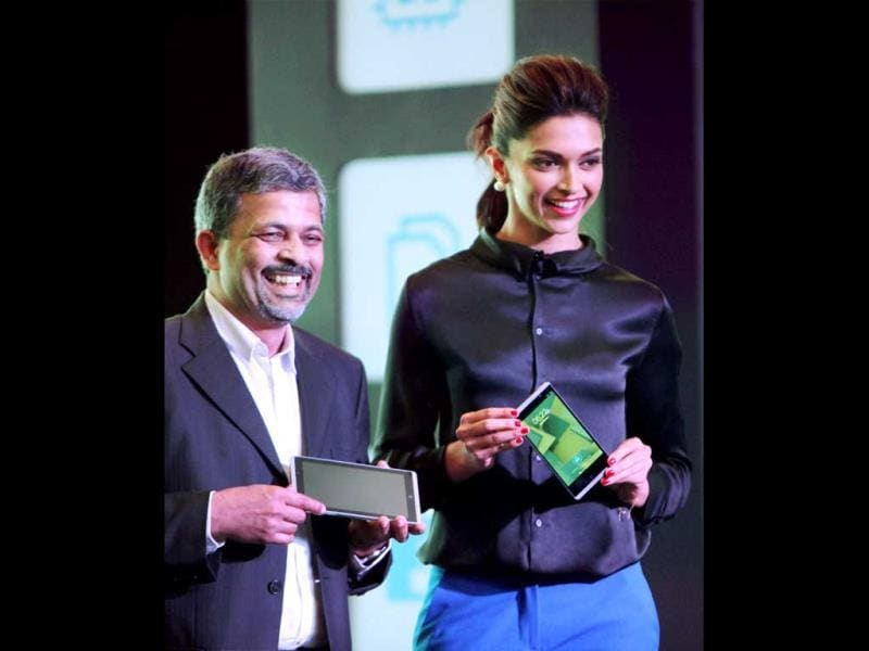 Deepika Padukone poses with Rajiv Srivastava, VP & GM, HP India, during the launch of HP State 6 voice tab and other products in New Delhi on Thursday. (PTI Photo)
