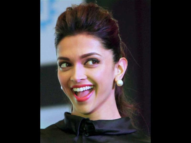 Is it love that makes her face shine? (PTI Photo)