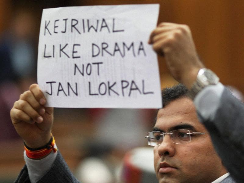 A BJP MLA shows a placard in the Delhi Assembly during its special session called for anti-corruption jan lokpal bill in New Delhi on February 14, 2014. (PTI photo)