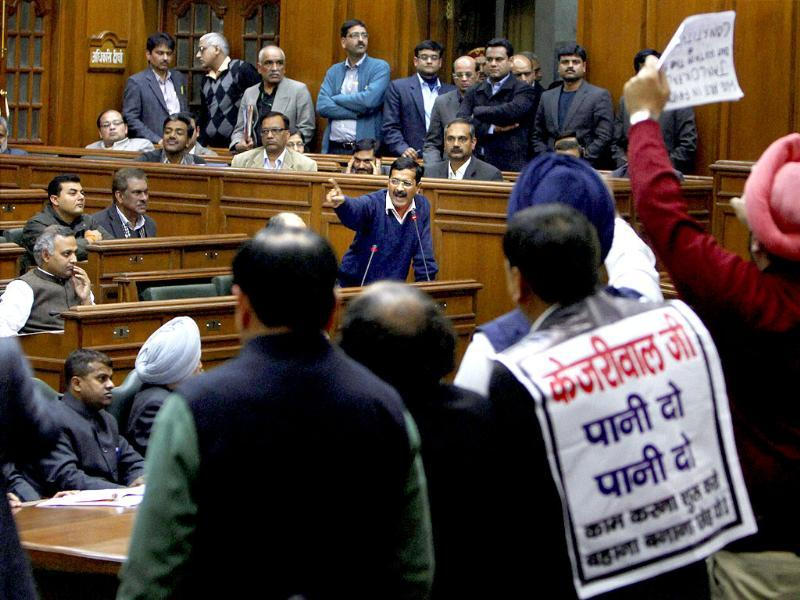 Delhi CM Arvind Kejriwal addresses the assembly amid protest by BJP's members during a special session called for anti-corruption jan lokpal bill in New Delhi. (PTI photo)