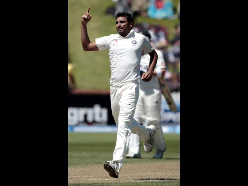 Mohammed Shami celebrates the wicket of New Zealand's Tom Latham during the second innings on day three of the second Test at the Basin Reserve in Wellington. (Reuters Photo)