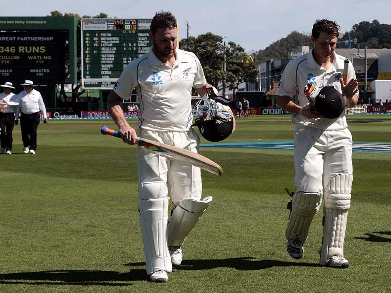 New Zealand's Brendon McCullum and BJ Watling (R) leave the pitch for tea with a record partnership in the second innings on day four of the second Test against India at the Basin Reserve in Wellington. (Reuters Photo)
