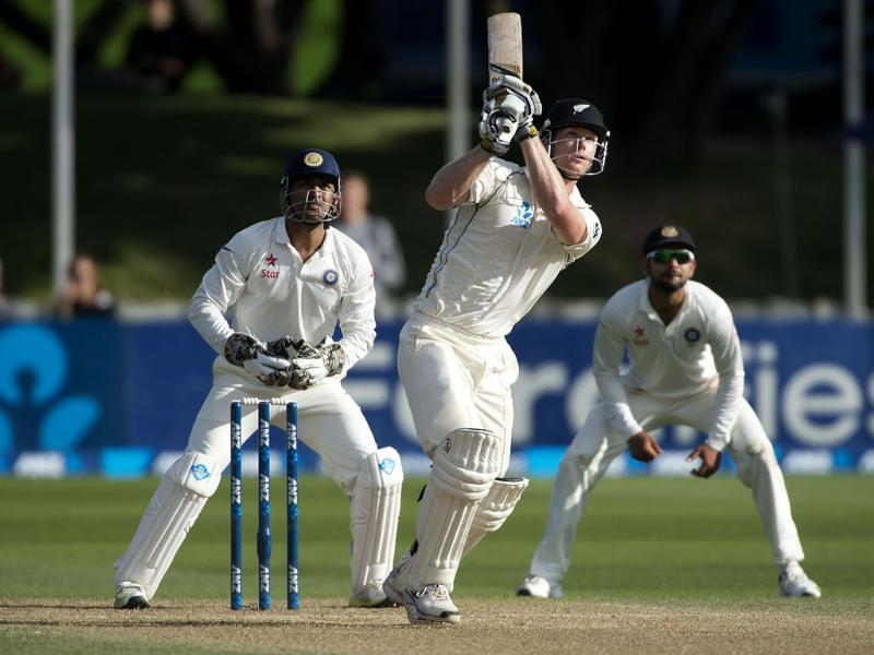 Jimmy Neesham (C) of New Zealand bats as MS Dhoni (L) and Mohammed Shami (R) lood on during Day 4 of the 2nd Test at the Basin Reserve in Wellington. (AFP Photo)