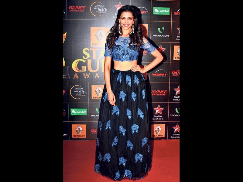 Deepika Padukone: She attended an awards show wearing a blue-and-black lace Shehlaa lehenga, bringing a quirky twist to a traditional garment. She finished the look with chandelier earrings and wavy hair.