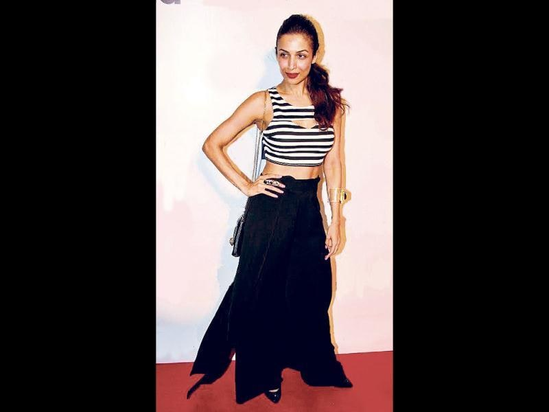 Malaika Arora Khan: At a photography exhibition, Malaika looked chic in a black-and-white crop top, paired with draped palazzo pants.