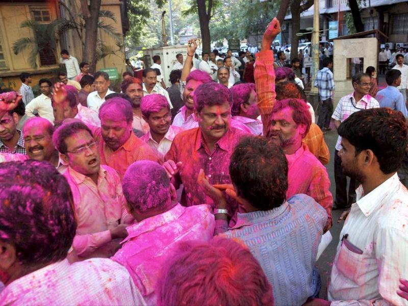 Pro-Telangana activists celebrate the passage of Telangana bill in the Lok Sabha in Hyderabad. (PTI photo)
