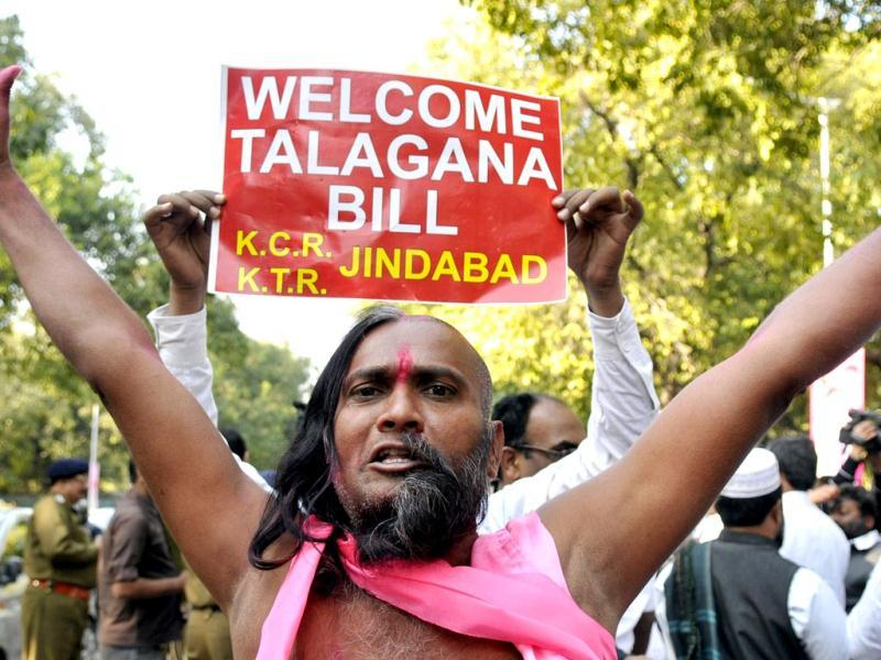 Telangana supporters celebrate the passage of Telangana bill in the Lok Sabha. (HT photo/Mohd. Zakir)